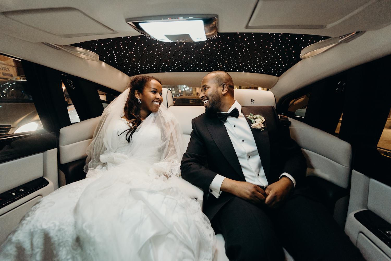 London wedding planning couple jetting off in Rolls Royce car
